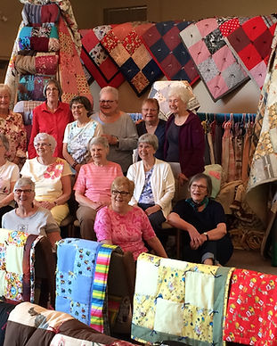 Group with Quilts 2015 Cda Lutheran.JPG