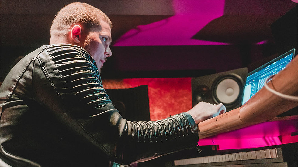 Sound Engineer Mixing and Mastering music in the studio