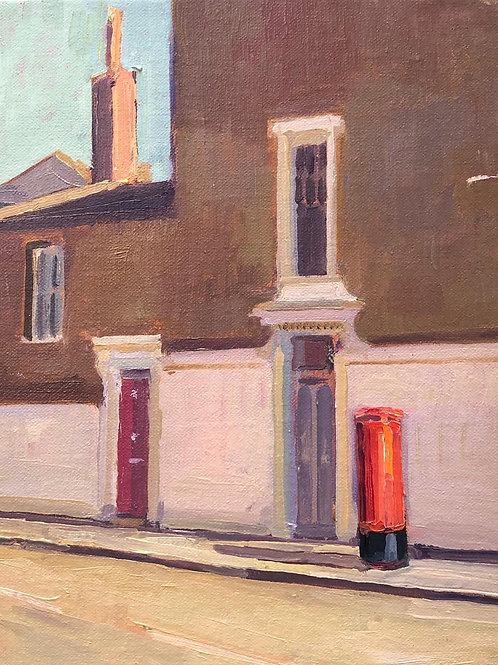 Red letter box and chimney pot