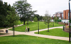 Image of two people walking on the path in Frank Banfield park