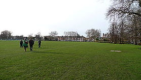 image of people walking on a sports pitch