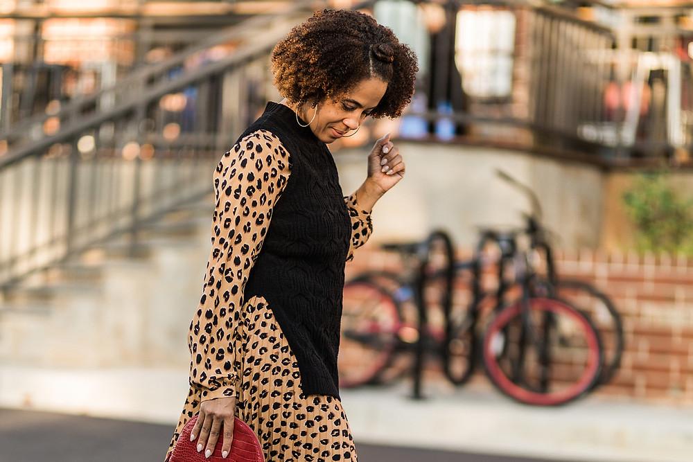 Woman wearing street style in a leopard print wrap dress