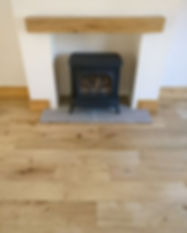 Restoration of real oak wood flooring, sanded and sealed with lacquer in a living room.