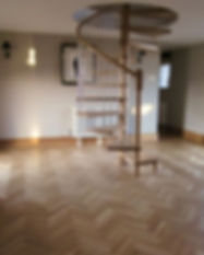 Real oak parquet flooring finished with laquer, in and around a spiral staircase.
