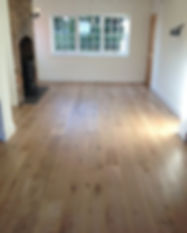 Real oak floorboards finished with laquer in a living room.