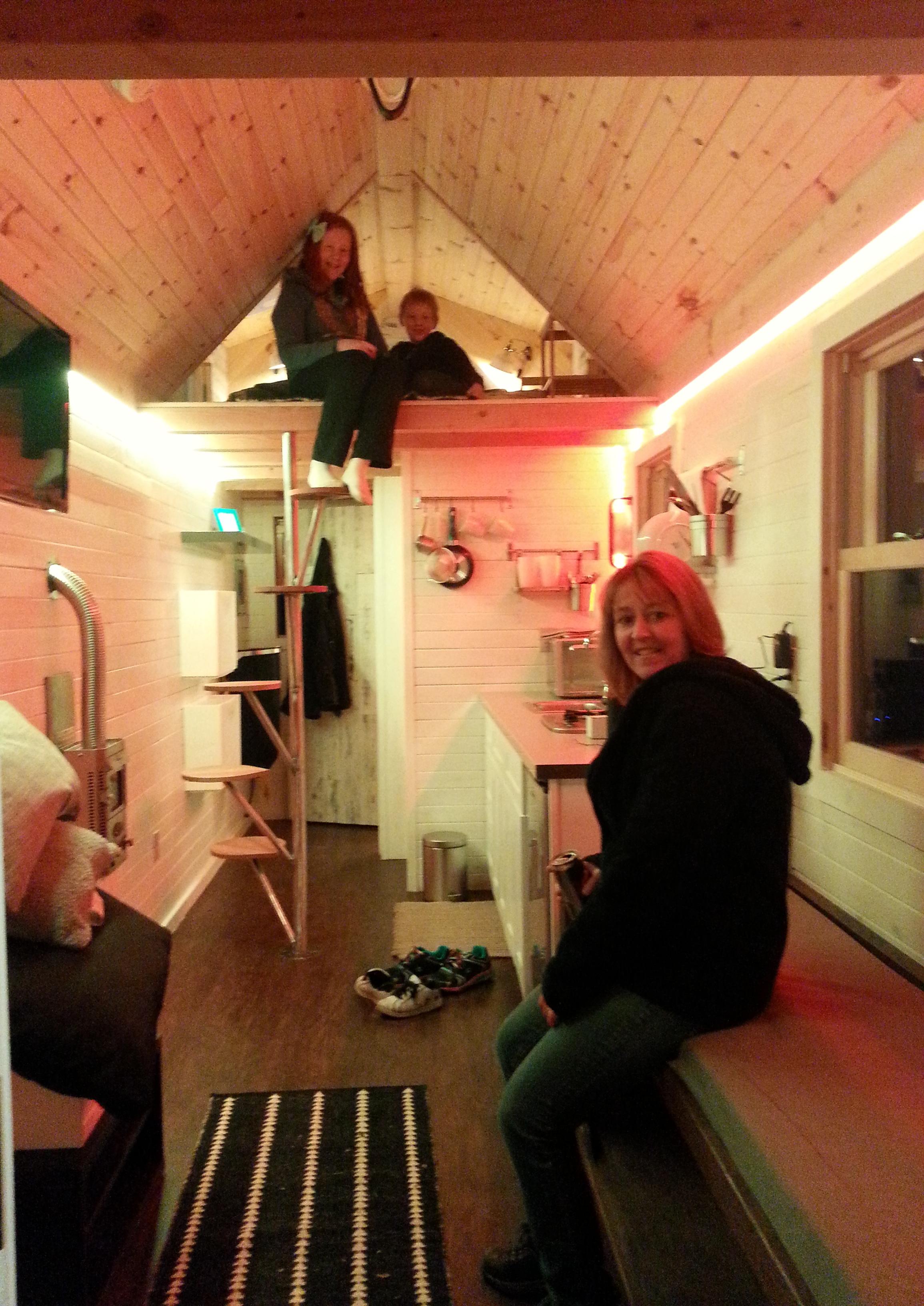 Harris family exploring tiny house