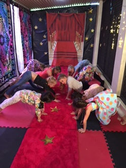 girls downward dog pose red carpet.jpg