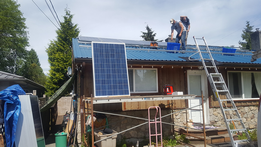 Alternative Power Solutions working on our roof