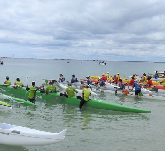 Mixed OC6 race. Beach start. 20 canoes..