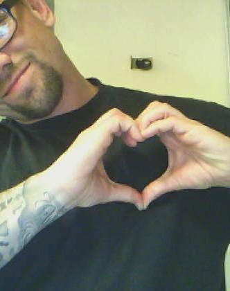 Ben photo - holding hands in heart.jpg