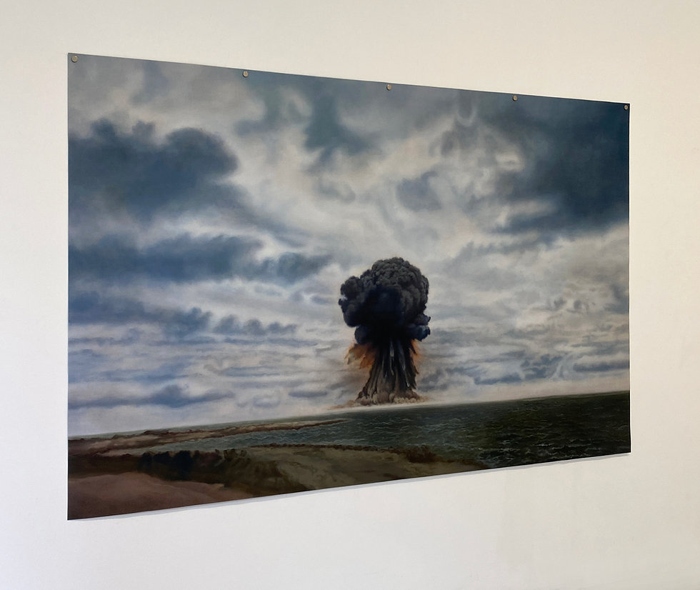 A large painting of an atomic explosion by artist Kirsty Harrus. The dark inky bomb is set centre stage within the dramatic skies of the MArshall Islands. The se is bluey green and there is a small stretch of beach on the bottom right. The painting is hung with magnets at the top as it is on un-stratched linen. Meaning it moves slightly in the breeze, or when people walk past. It is titled after the nuclear Test Hardtack Juniper.
