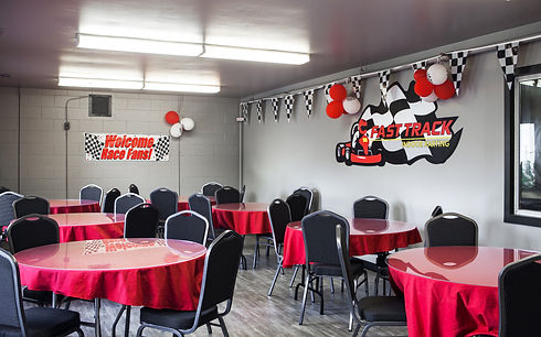 Party room decorated for a birthday party at indoor go kart facility