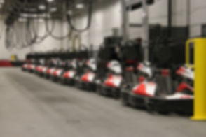 Go karts lined up in pit row