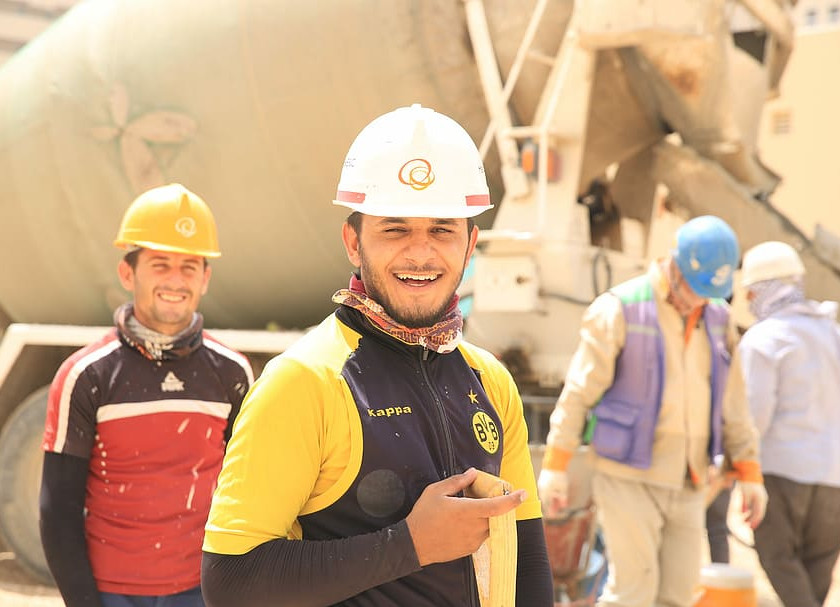 Occupational wellness - Construction worker smiling