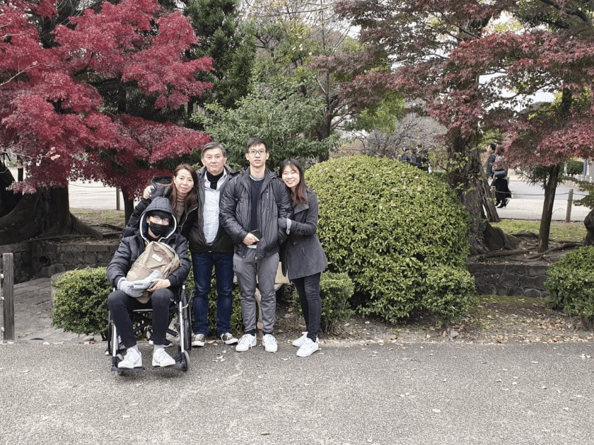 Ankylosing Spondylitis - Sitting on wheelchair in Japan with family