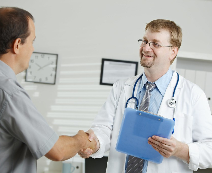 Occupational wellness - Doctor shaking hand with patient