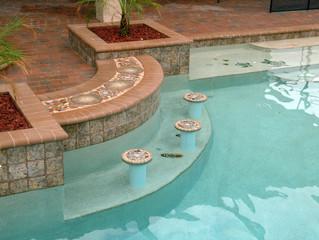 Swim up pool bar with custom tile mosaic