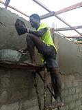 Plastering man Alie Bangura.jpg
