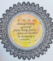 Handdrawn mandala with watercolor and pointed pen