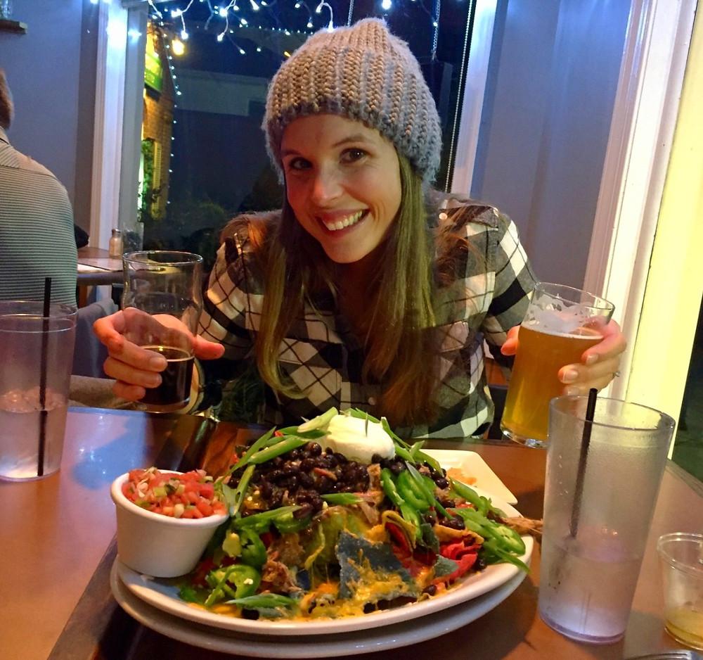 woman enjoying nachos
