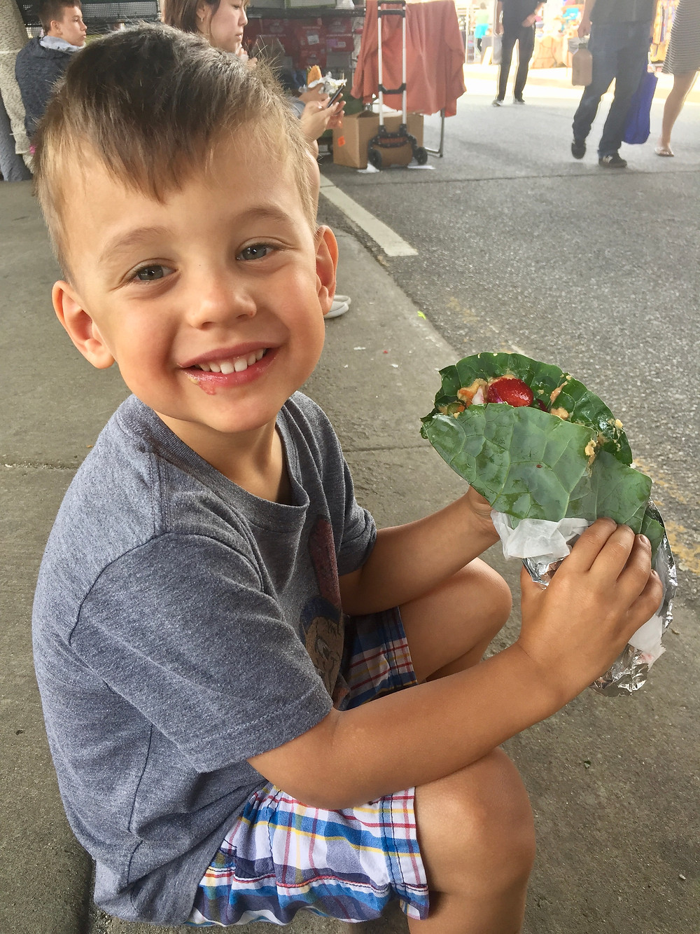 Kid eating at farmers market