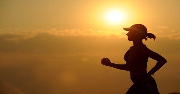 woman focusing on crushing her running goal