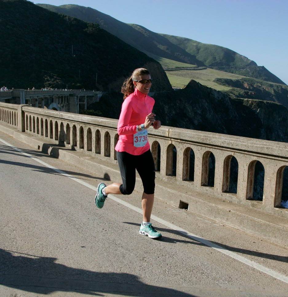 Healthy woman running on road