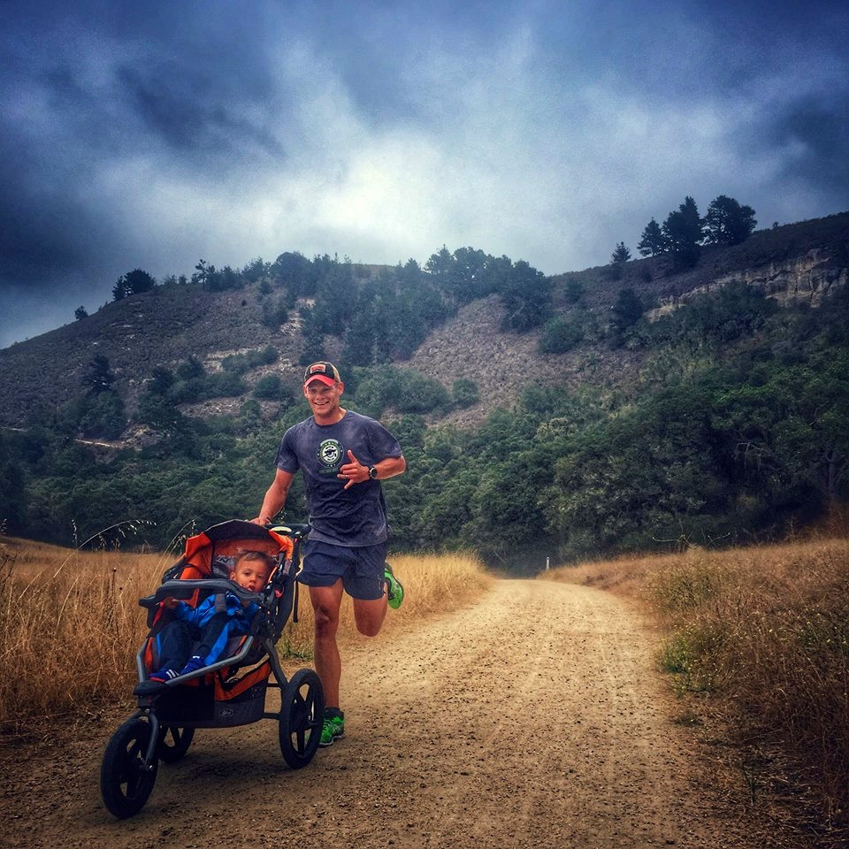 Father running with stroller in mountains