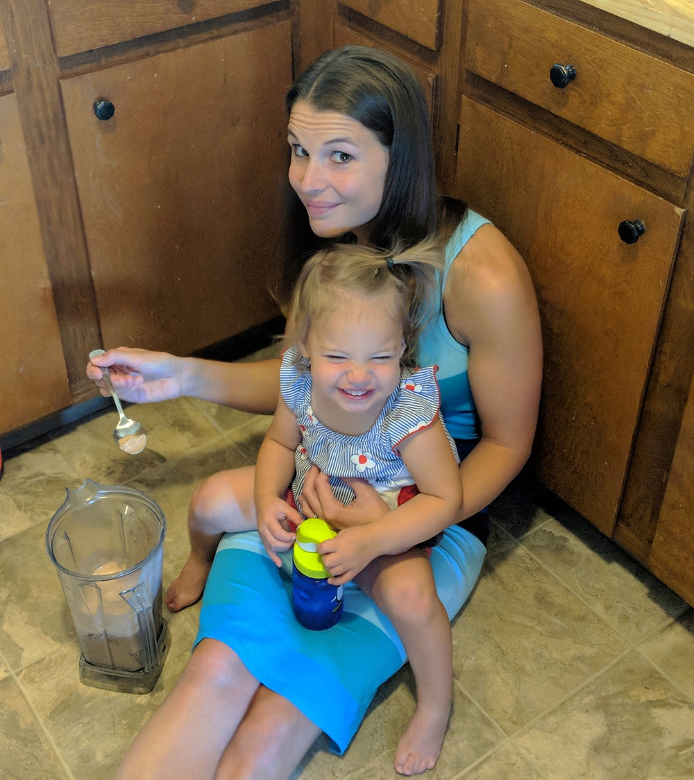 Mother and daughter making protein shakes