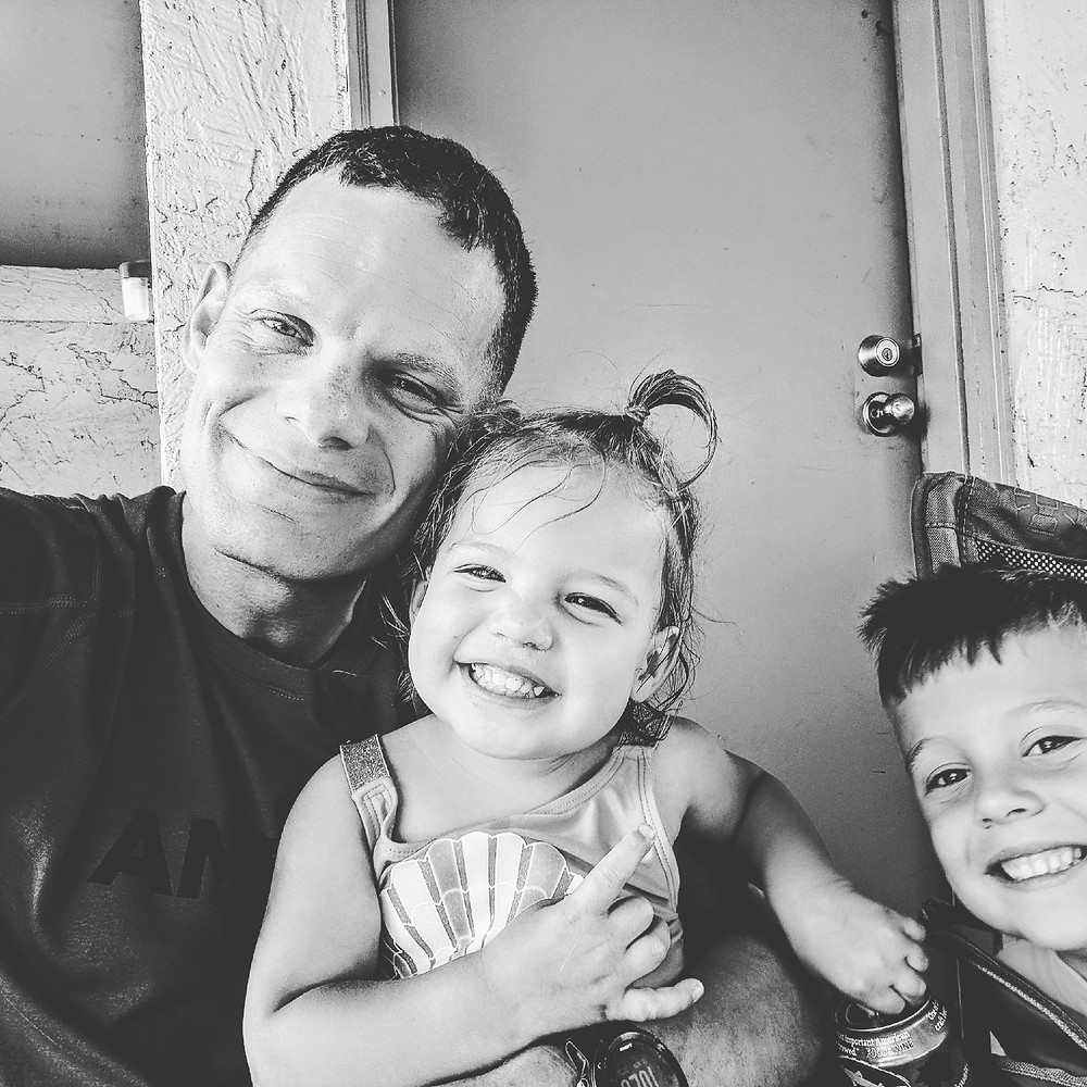 Father with smiling children