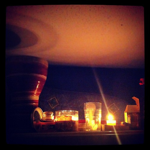 348: power is out, so I read by candle light.