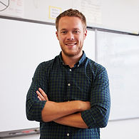 The Nurture Room | Mental health in schools | A confident male teacher standing by a whiteboard
