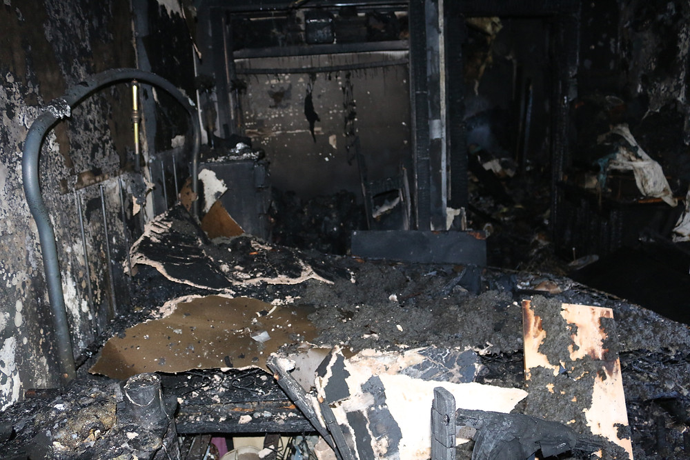 Room completed burned and destroyed by a fire with bed frame still recognizeable