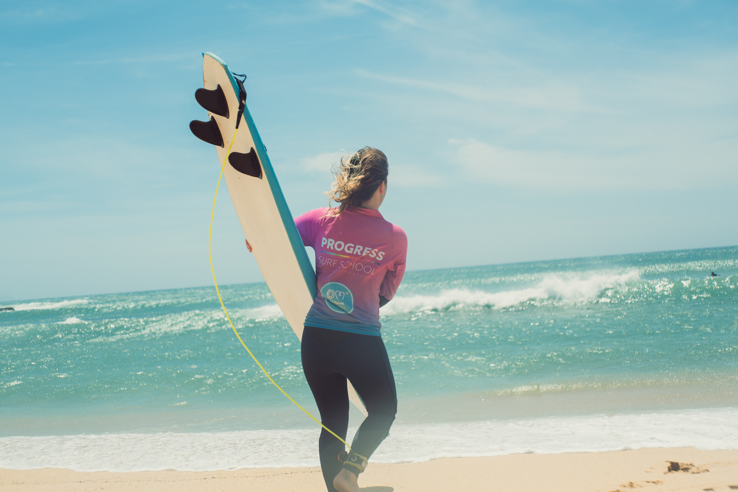 BIG vs SMALL Joana Andrade with surf board.jpg
