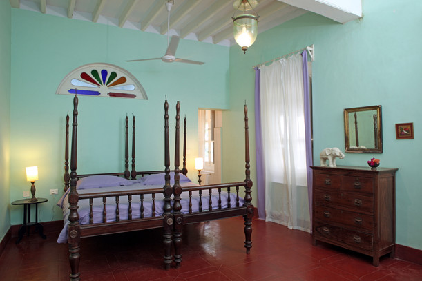 green bedroom double vintage antic bed window colourBed and Breakfast Holy Chic homes la vie en rose pondicherry india interior design style french quarters colonial architecture true vintage traditional agathe lazaro