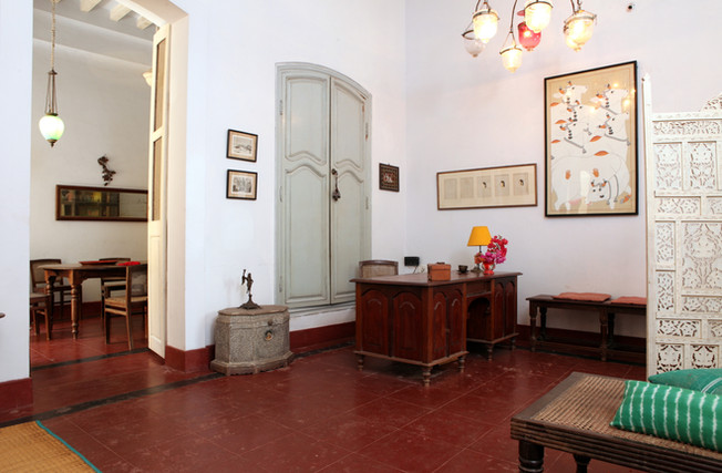 chandeliers entrance desk design interiors Leaving room books reading coffee rest arch architecture colonial french traditionalHoly Chic Homes La Vie en Rose Pondicherry India agathe desmond lazaro