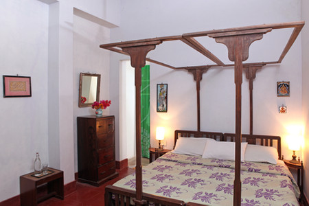mauve bedroom double bed Bed and Breakfast Holy Chic homes la vie en rose pondicherry india interior design style french quarters colonial architecture true vintage traditional agathe lazaro