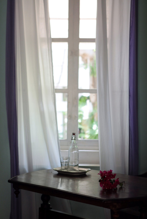 Window wrtier desk water bougainvillea Bed and Breakfast Holy Chic homes la vie en rose pondicherry india interior design style french quarters colonial architecture true vintage traditional agathe lazaro