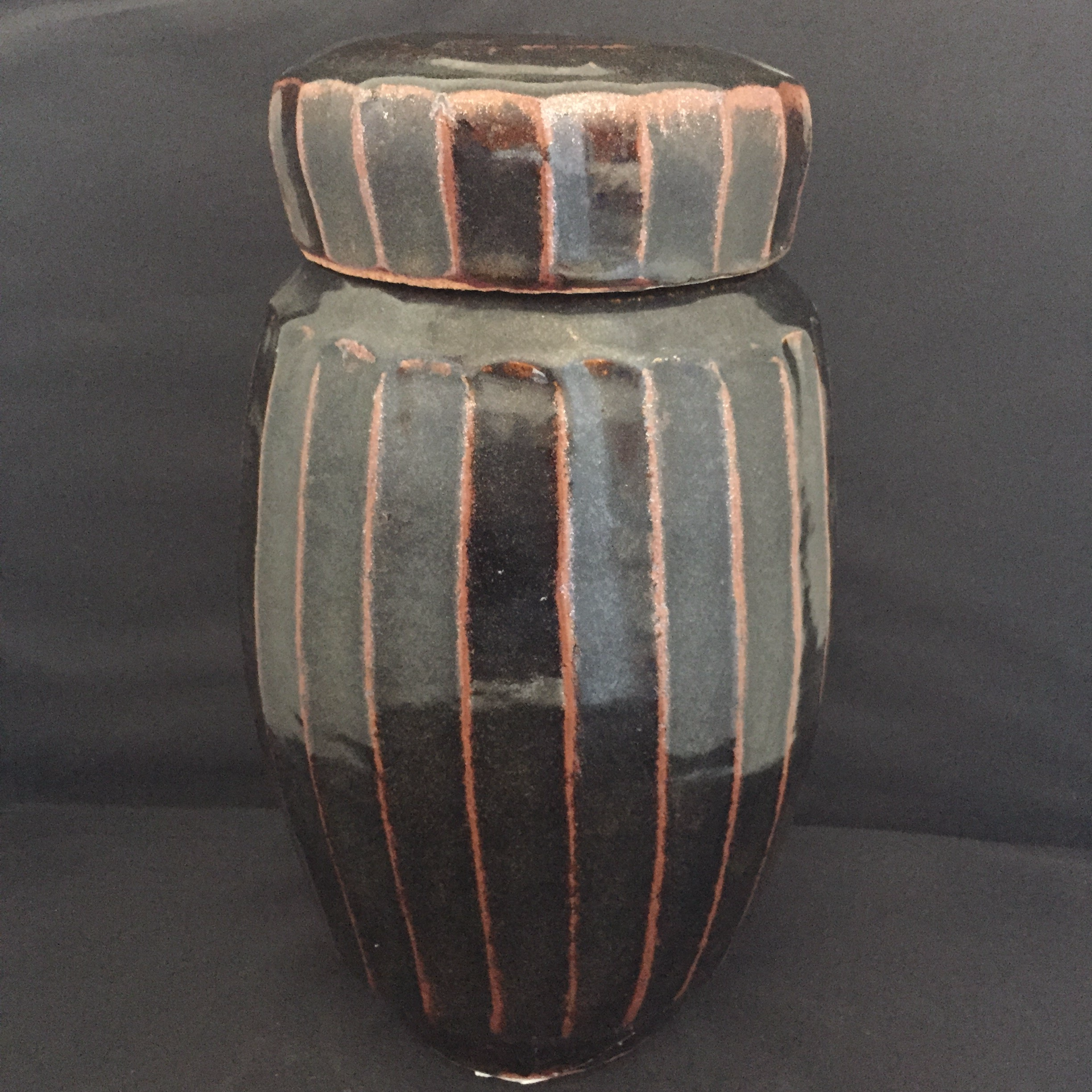 Tall fluted covered vase