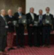 Photograph of wasim Mahmalji receiving an award