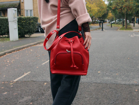 The one with the Red Handbag