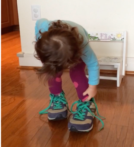 My niece dances in her mama's zip-zup shoes.