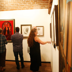 Guests inspecting the art.