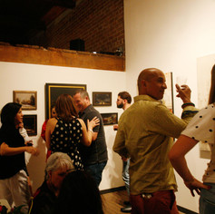 Guests enjoying the art, eachother's company..... and cake!