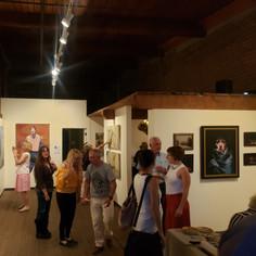 Artist, Inna Rohr, showing guests around.