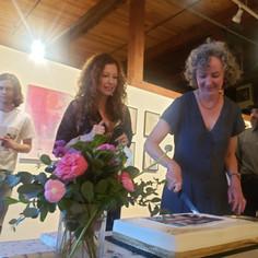 Artists, Jessie Shinn & Kathryn Gastelum, serving cake.