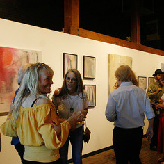 Artsit, Jennie Norris, sharing stories with guests.