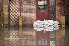 Sandbags Outside Front Door Of Flooded H