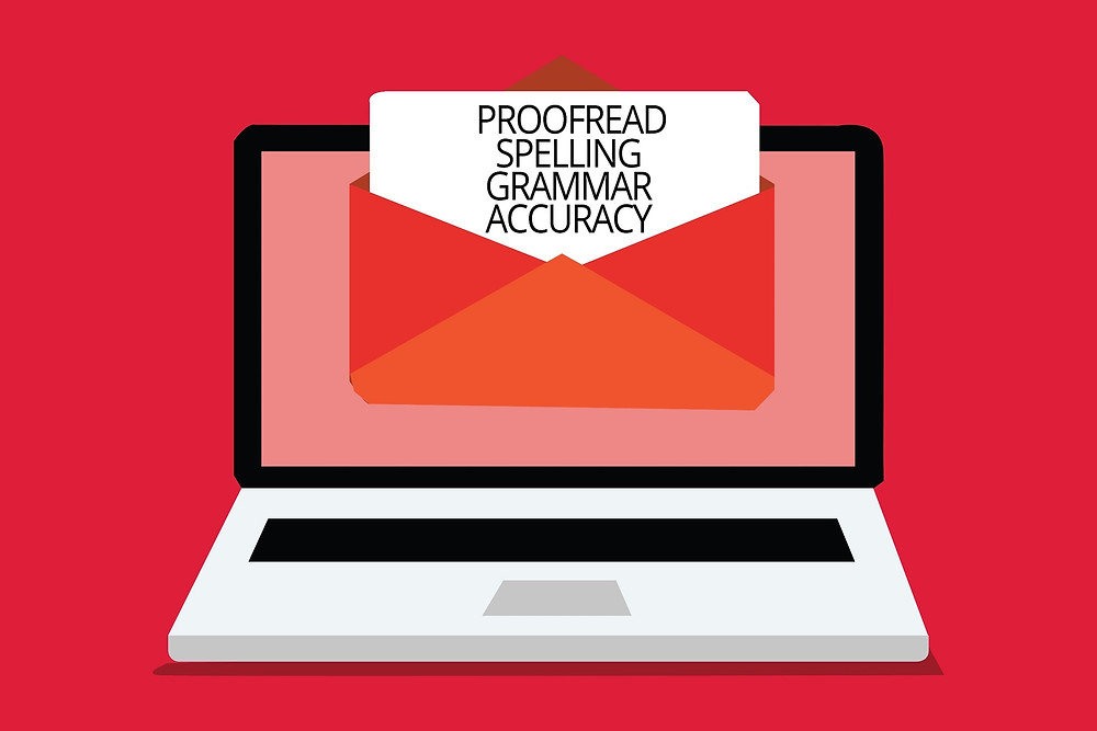 A laptop with an open email that has the words: Proofread, spelling, grammar, and accuracy.