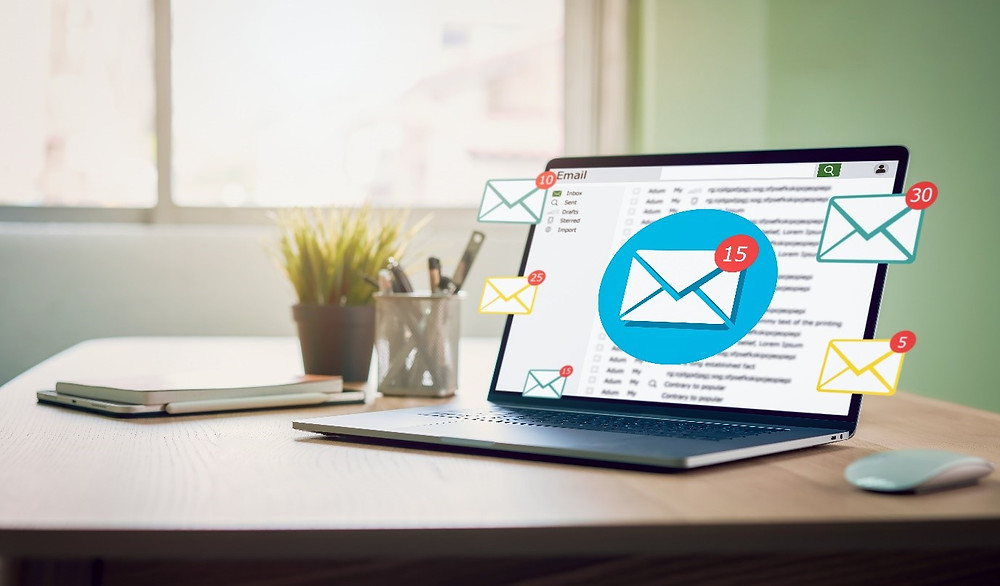 Email notifications on a computer screen displaying an email inbox